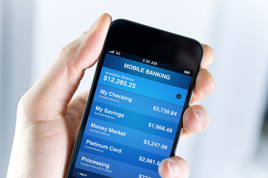 A man holding smartphone with mobile banking application on a screen. Closeup shot.