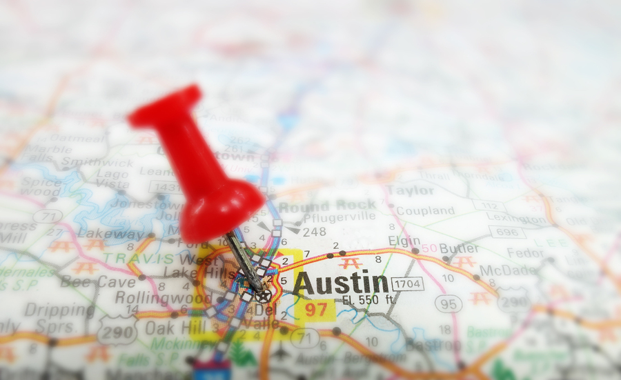 Closeup of a map of Austin Texas with red tack