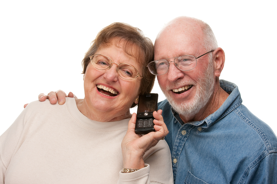 Happy Senior Couple Using Cell Phone Isolated on a White Background.