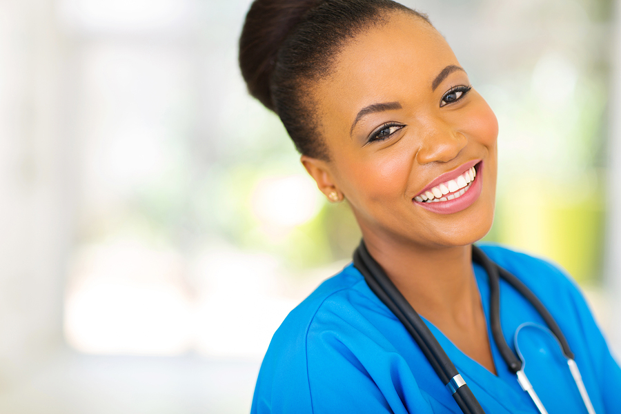 happy african nurse looking at the camera