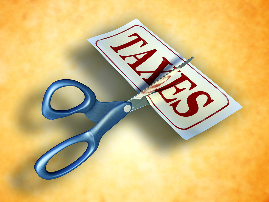 Some scissors are cutting a piece of paper with the word taxes. Digital illustration. Included clipp