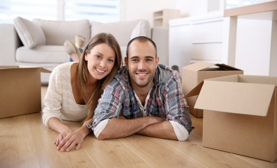 Young adults moving in new home